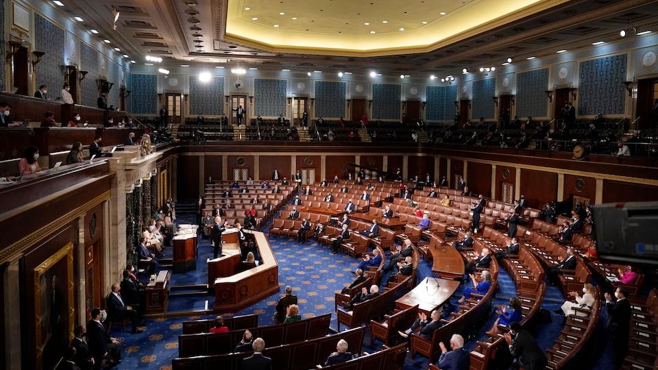 Joe Biden gives a speech to Congress which has several vacant seats.