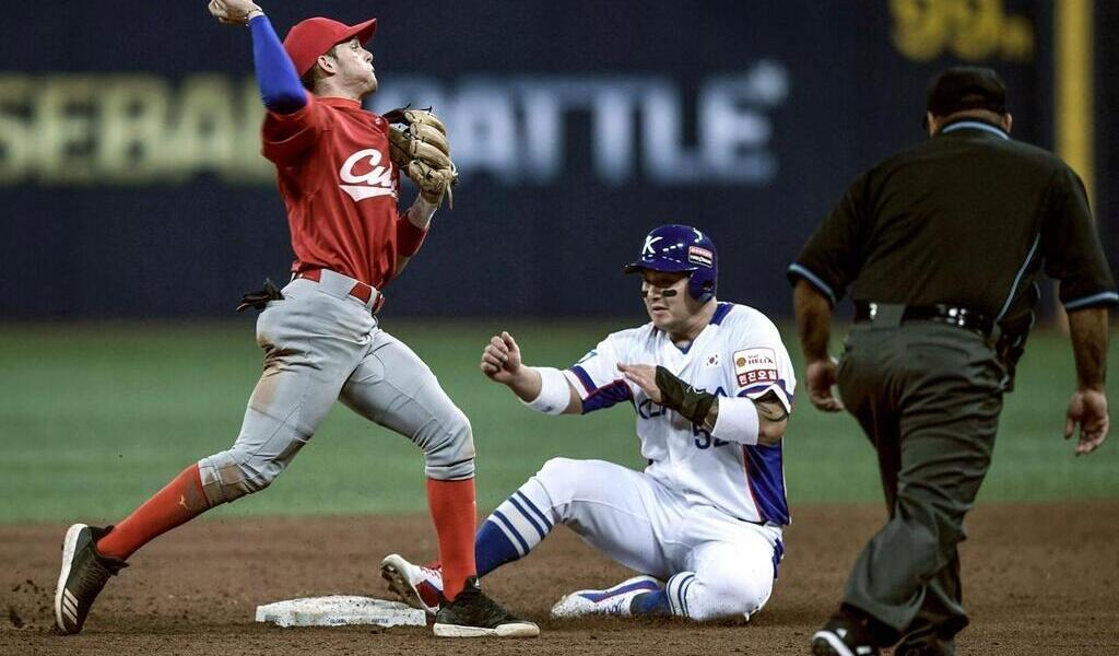Baseball.  A Cuban soldier abandoned his delegation when he arrived in the United States.  Sports