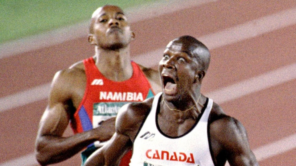 Donovan Bailey screaming after crossing the finish line.