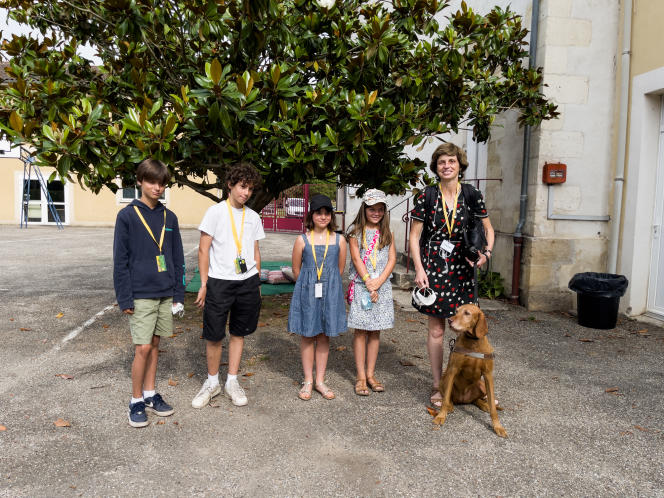 Sophie Maceo, blind journalist and author, with children from