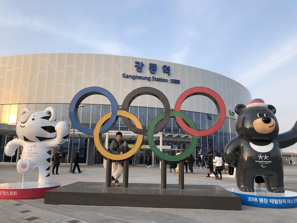 Kazunori Takeshima in front of the Olympic rings in South Korea.