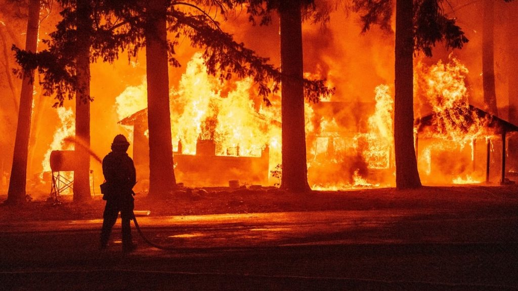 California firefighters face a fire that creates their own atmosphere