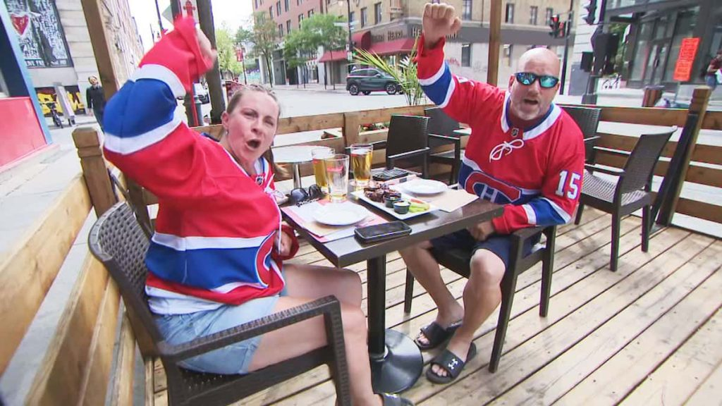 Fans gather with a fan in downtown Montreal