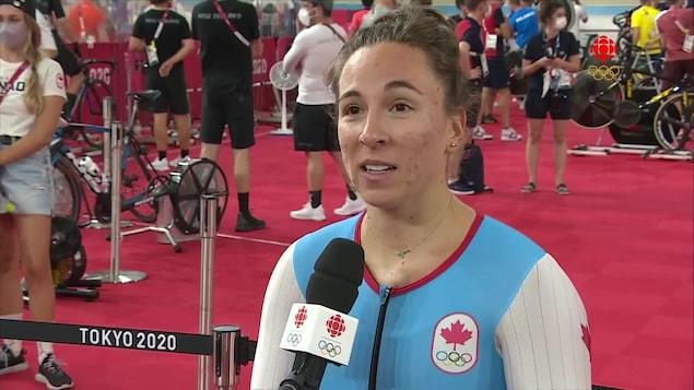 Lauren Genest speaks into a microphone.