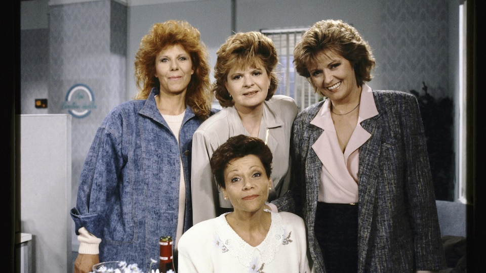 The four actresses are smiling.