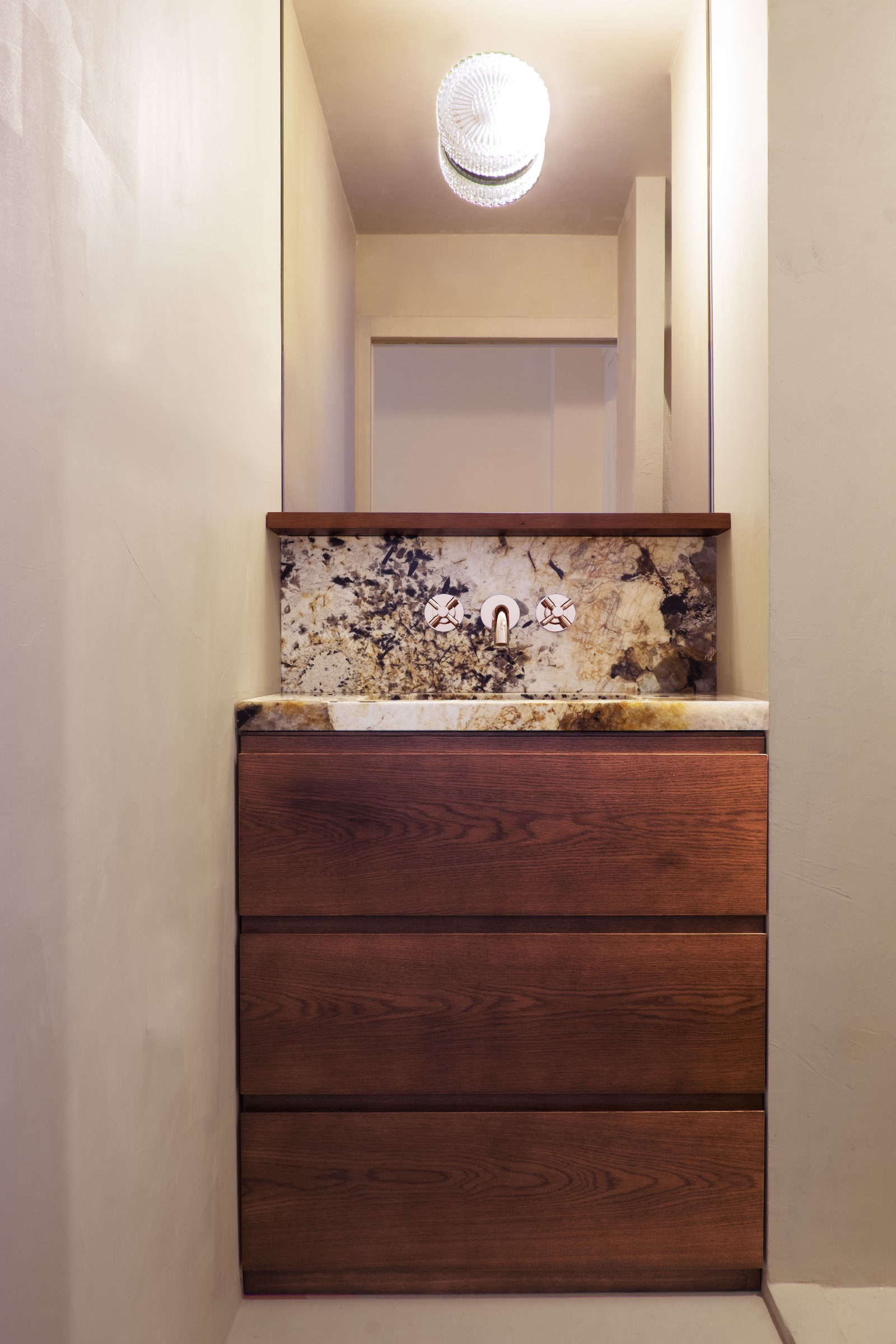 The bathroom, all in beige waxed concrete, is like a cozy little cocoon where everything falls into place.  drawer unit...