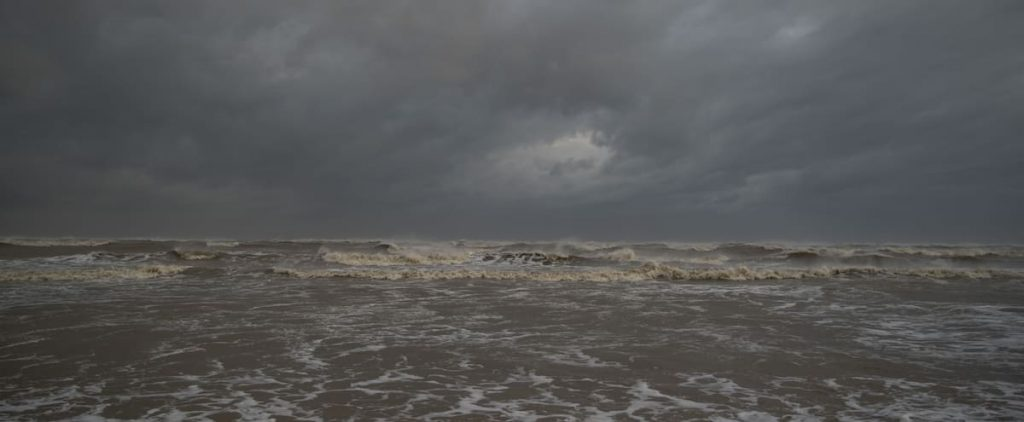 to see |  Robot photographing waves from inside a hurricane